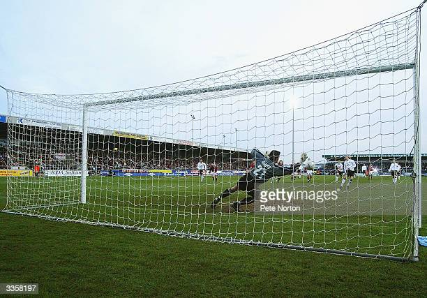 Lee Harper of Northampton Town saves the penalty kick from Diego Forlan of Manchester United during the FA Cup fourth round match between Northampton...