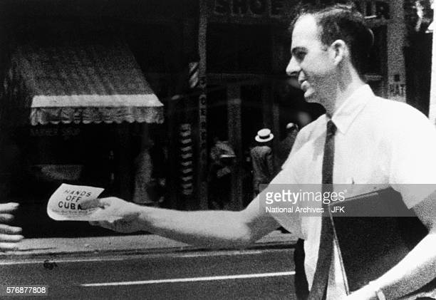 Lee Harvey Oswald distributes Hands Off Cuba flyers on the streets of New Orleans Louisiana This photograph was used in the Kennedy assassination...