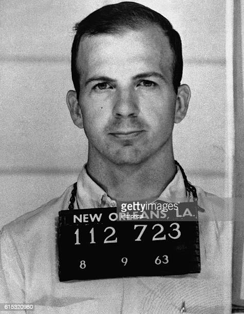 Lee Harvey Oswald in a police photo after being arrested for protesting US policy in Cuba On November 22 he was arrested on charges of assassinating...
