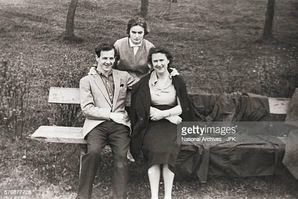 Lee Harvey Oswald sits in a park with Marina Nikolayevna Prusakova and her aunt Valentina Guryevna.