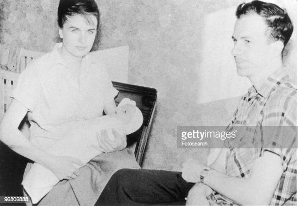 Lee Harvey Oswald sitting with wife Marina Oswald and son June Oswald circa 1950s