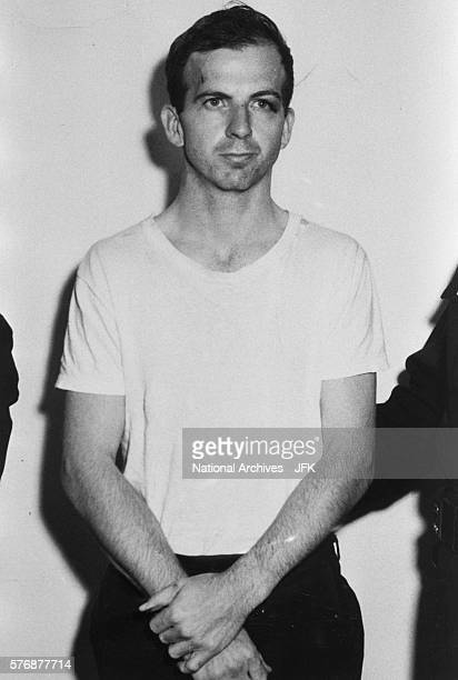 Lee Harvey Oswald stands detained by the Dallas Police Department following his arrest for possible involvement in the John F Kennedy assassination...