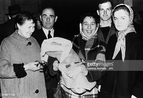 Lee Harvey Oswald with Marina and friends in Russia before boarding the train for their departure from the country