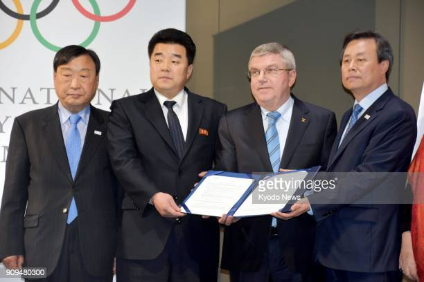 Lee Hee Beom president of the Pyeongchang Olympics organizing committee Kim Il Guk president of the North Korean Olympic Committee Thomas Bach...