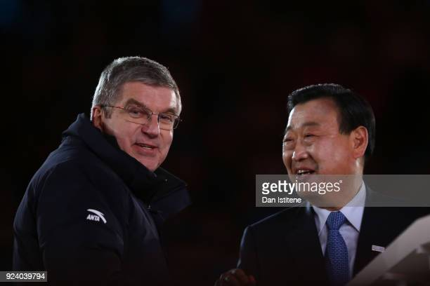 Lee Heebeom President CEO of PyeongChang Organizing Committee and President of the International Olympic Committee Thomas Bach shake hands during the...