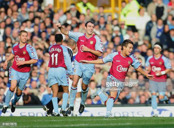 Lee Hendrie of Aston Villa celebrates scoring his goal during the Barclays Premiership match between Everton and Aston Villa at Goodison Park on...