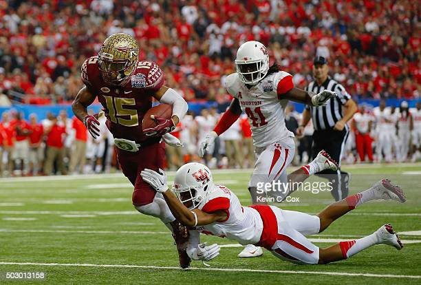 Lee Hightower of the Houston Cougars tackles Travis Rudolph of the Florida State Seminoles in the third quarter during the ChickfilA Peach Bowl at...