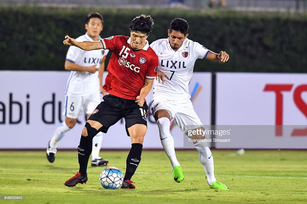 Lee Ho #15 of Muangthong United (L) and Pedro Junior #7 of Kashima Antlers (R) competes for the ball during the AFC Asian Champions League match between Muangthong United and Kashima Antlers at Supachalasai National Stadium on February 28, 2017 in Bangkok, Thailand.