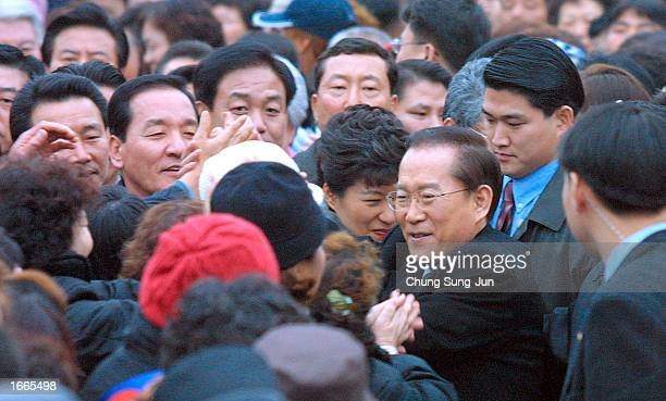 Lee HoiChang Grand National Party 's presidential candidate greets supporters during a campaign rally November 29 2002 in Suwon South Korea Lee and...