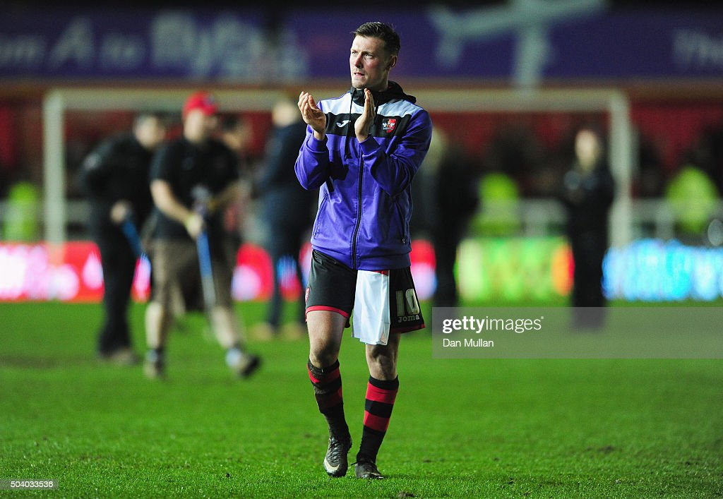 Lee Holmes of Exeter City applauds the crowd as they draw after the Emirates FA Cup third round match between Exeter City and Liverpool at St James Park on January 8, 2016 in Exeter, England.