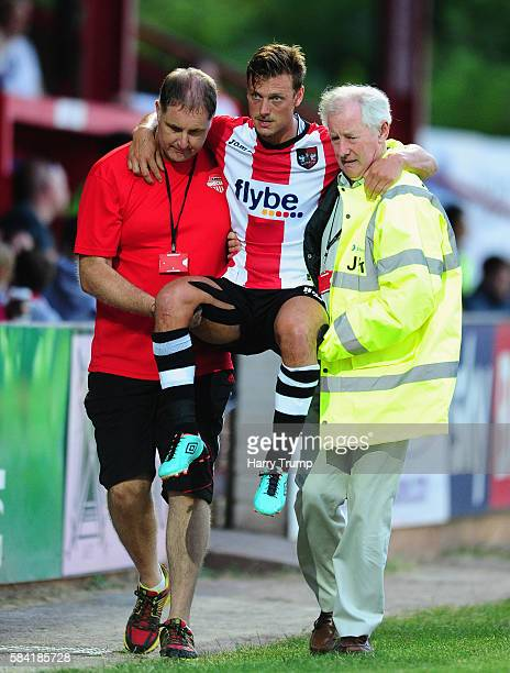 Lee Holmes of Exeter City is carried from the field after picking up an injury during the Pre Season Friendly match between Exeter City and Cardiff...