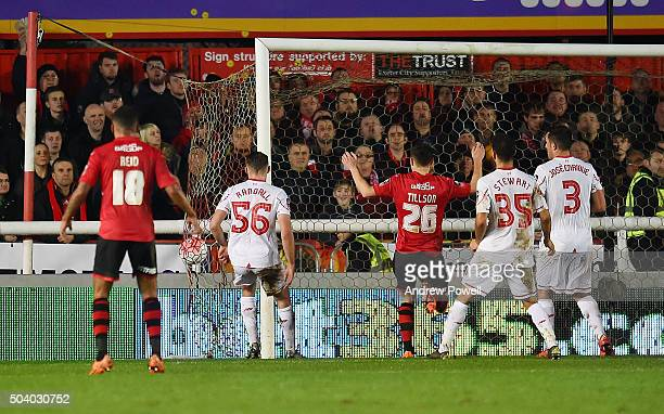 Lee Holmes of Exeter City scores the second goal from a corner during the Emirates FA Cup third round match between Exeter City and Liverpool at St...