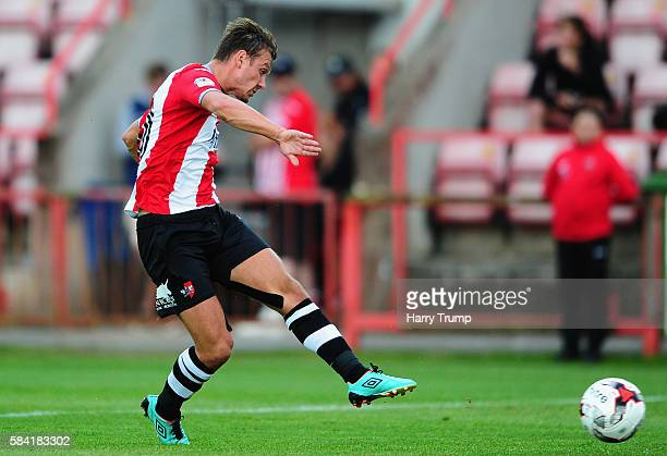 Lee Holmes of Exeter City sxores his sides first goal during the Pre Season Friendly match between Exeter City and Cardiff City at St James Park on...