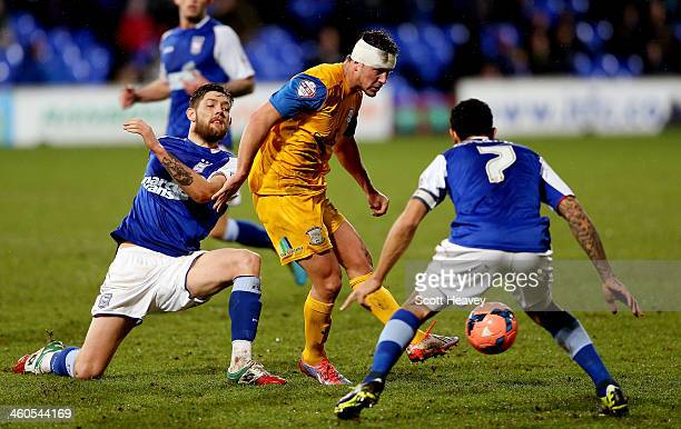 Lee Holmes of Preston in action during the FA Cup Third Round match between Ipswich Town and Preston North End at Portman Road on January 4 2014 in...