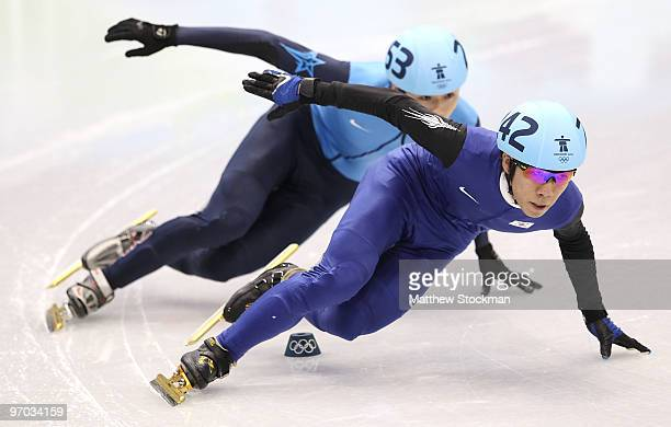 Lee HoSuk of South Korea leads Simon Cho of the United States in the Short Track Speed Skating Men's 500m heat on day 13 of the 2010 Vancouver Winter...