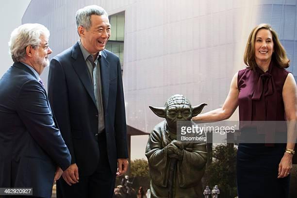 Lee Hsien Loong Singapore's prime minister center billionaire George Lucas filmmaker and founder of Lucasfilm Ltd left and Kathleen Kennedy president...