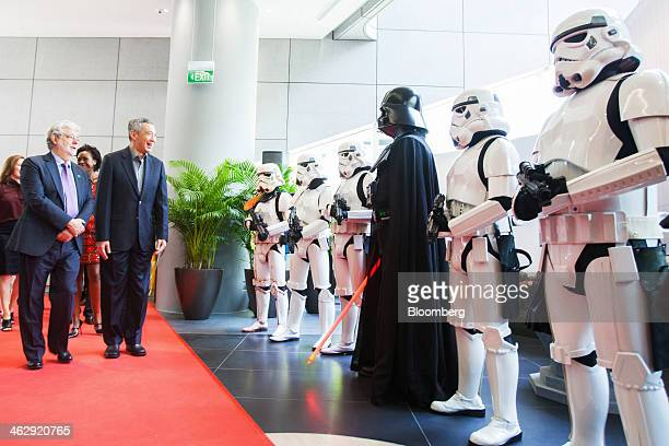 Lee Hsien Loong Singapore's prime minister fourth left and billionaire George Lucas filmmaker and founder of Lucasfilm Ltd second left are greeted by...