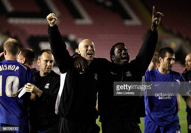 Lee Hughes and Ade Akinbiyi of Notts County celebrate after winning the Coca Cola League Two title after the Coca Cola League Two match between...