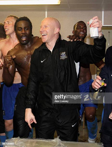 Lee Hughes and Ade Akinbiyi of Notts County celebrate in their dressing room after winning the Coca Cola League Two title after the Coca Cola League...