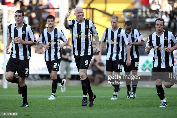 Lee Hughes of Notts County celebrates after scoring his third and his sides fifth goal during the Coca Cola League Two match between Notts County and...