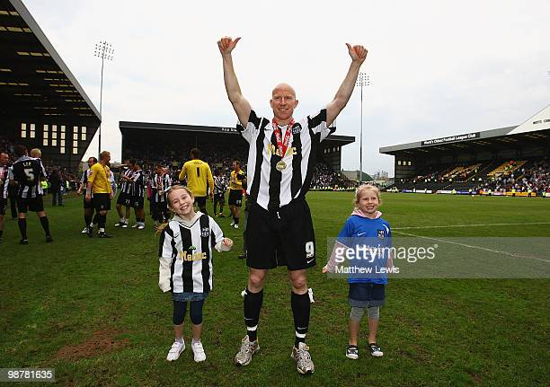 Lee Hughes of Notts County celebrates winning the CocaCola League Two Championship after the CocaCola League Two match between Notts County and...