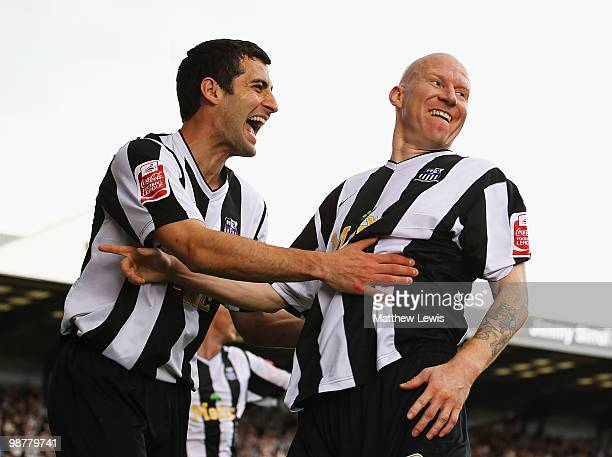 Lee Hughes of Notts County is congratulated by Mike Edwards after scoring his second goal during the CocaCola League Two match between Notts County...