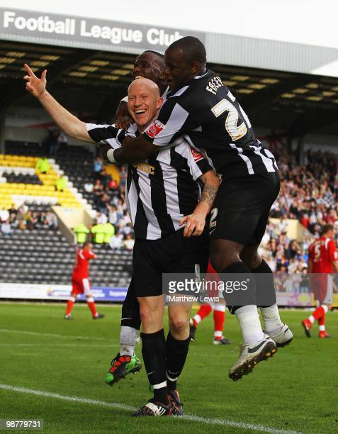 Lee Hughes of Notts County is congratulated on his goal during the CocaCola League Two match between Notts County and Cheltenham Town at Meadow Lane...