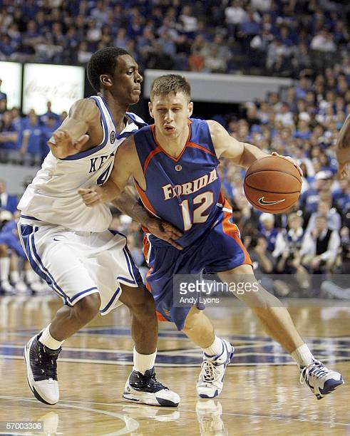 Lee Humphrey of the Florida Gators dribbles the ball while defended by Rajon Rondo of the Kentucky Wildcats during the Gators 79-64 win over the...