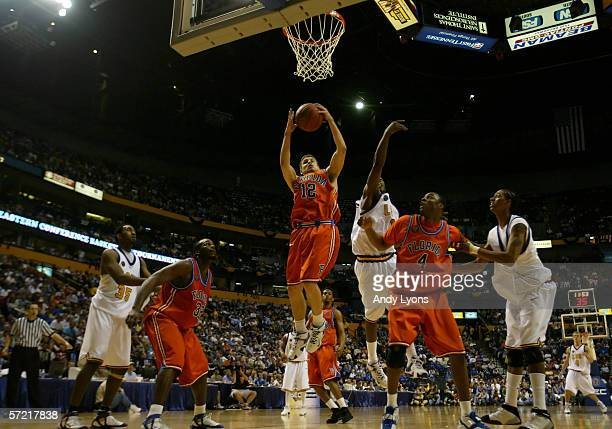 Lee Humphrey of the Florida Gators grabs a rebound against the LSU Tigers during the semifinals on day 3 of the SEC Men's Basketball Conference...