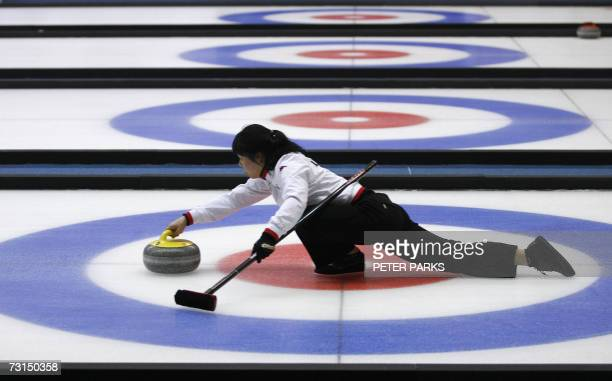 Lee HyeIn of the Korean women's curling team launches the stone down the ice against China at the Asian Winter Games in Changchun in China's...