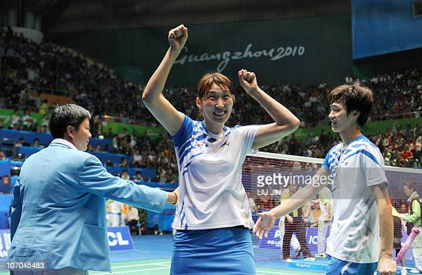 Lee HyoJung and Shin BaekCheol of South Korea celebrate after beating Zhang Nan and Zhao Yunlei of China during their mixed doubles final at the 16th...
