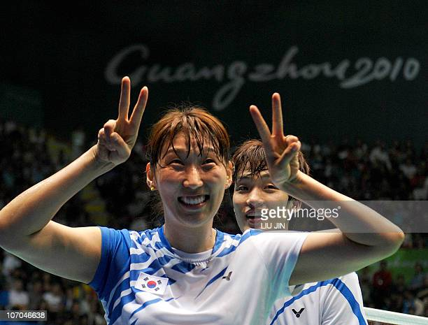 Lee HyoJung and Shin BaekCheol of South Korea celebrate after beating Zhang Nan and Zhao Yunlei of China during the mixed doubles badminton final at...