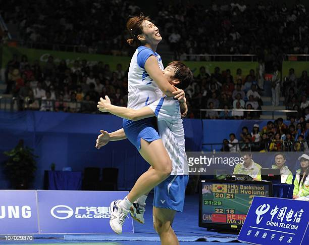 Lee HyoJung of South Korea celebrates with her partner Shin BaekCheol after beating He Hanbin and Ma Jin of China during their mixed doubles...