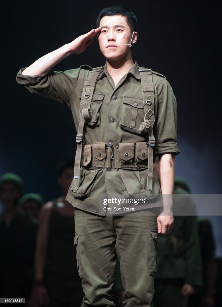 Lee Hyun of 8eight performs during the musical 'The Promise' press call at the National Theater of Korea Main Hall 'Hae' on January 8, 2013 in Seoul, South Korea.
