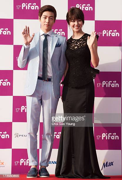 Lee HyunWoo and Fujii Mina pose for photographs upon arrival during 17th Puchon International Fantastic Film Festival Opening Ceremony at Bucheon...