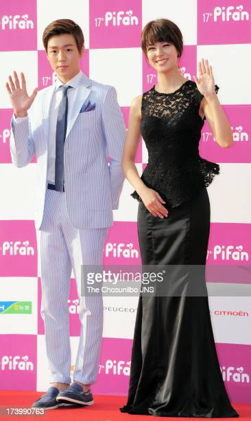 Lee Hyun-Woo and Fujii Mina pose for photographs upon arrival during 17th Puchon International Fantastic Film Festival Opening Ceremony at Bucheon...