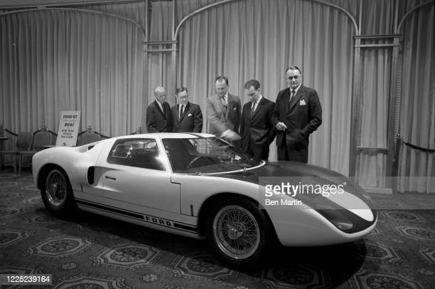 Lee Iacocca automobile executive, displaying a Ford GT at an auto show, 1964.