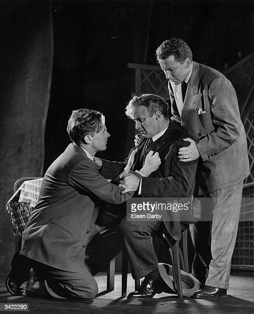 Lee J Cobb seated with Arthur Kennedy and Cameron Mitchell in a production of Arthur Miller's Pulitzer Prize winning play 'Death Of A Salesman'