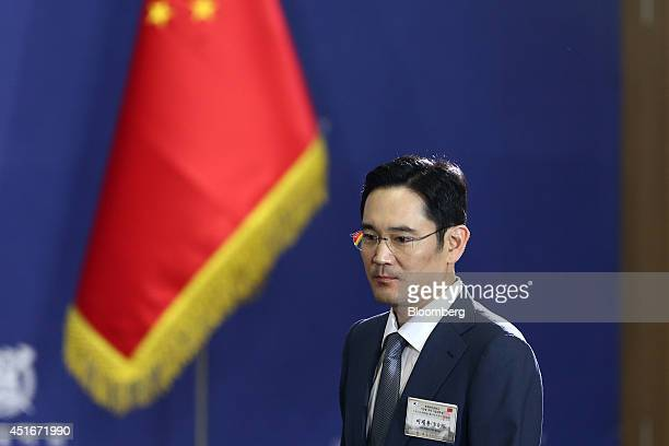 Lee Jae Yong, vice chairman of Samsung Electronics Co., arrives for an event with Xi Jinping, China's president, unseen, at Seoul National University...