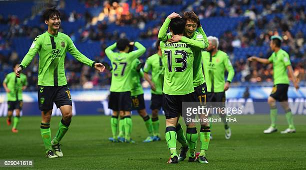 Lee Jaesung of Jeonbuk Hyundai congratulates goalscorer Kim Bokyung of Jeonbuk Hyundai after he scored the opening goal during the FIFA Club World...