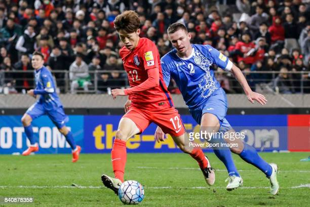 Lee Jaesung of Korea Republic fights for the ball with Egor Krimets of Uzbekistan during the 2018 FIFA World Cup Russia Asian Qualifiers Final...