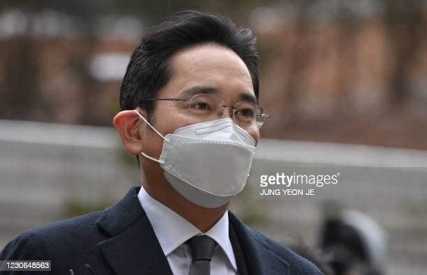 Lee Jae-yong, vice chairman of Samsung Electronics, arrives at a court for a trial in his bribery scandal involving former South Korean president...