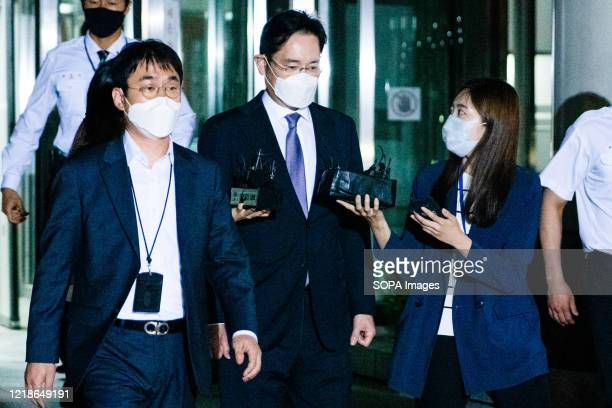 Lee Jae-yong, vice chairman of Samsung Electronics, leaves the Seoul Central District Court after a hearing on the prosecution's request for a...