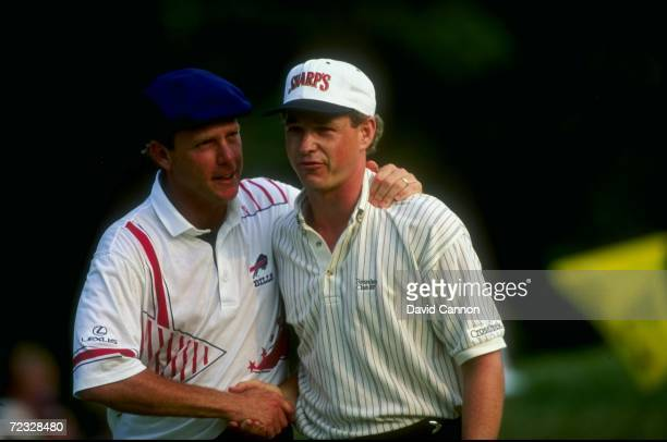 Lee Janzen of the USA is congratulated by Payne Stewart during the 1993 U.S. Open at the Batusrol Golf Club in Springfield, New Jersey. Janzen went...