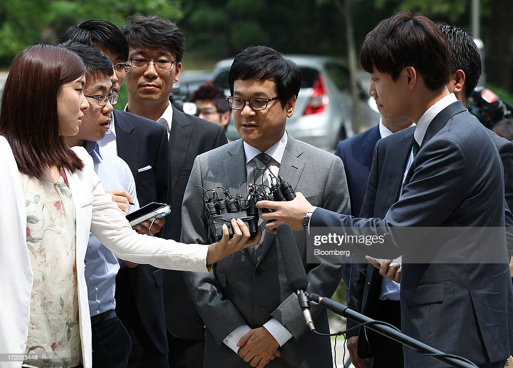 Lee Jay Hyun, chairman of CJ Group, center, is surrounded by members
