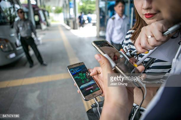 Lee Jeonghwan and Barbie Lim broadcasting jockeys for Pokemon Go Korea Facebook page broadcast live as Lee plays the game at the Express Bus...