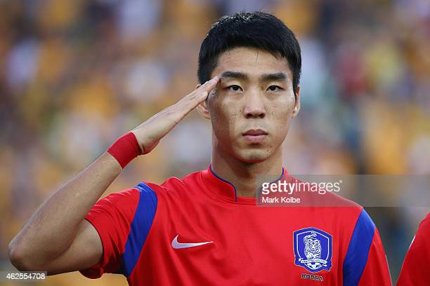 Lee Jeonghyeop of Korea Republic salutes during the anthem ahead of the 2015 Asian Cup final match between Korea Republic and the Australian...