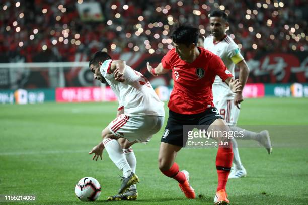 Lee JeongHyeop of South Korea competes for the ball with Omid Ebrahimi Zarandini of Iran during the international friendly match between South Korea...