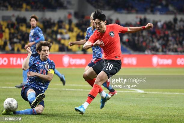 Lee Jeong-hyeop of South Korea competes for the ball with Sho Sasaki of Japan during the EAFF E-1 Football Championship match between South Korea and...