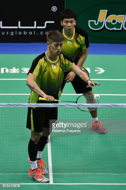 Lee Jhe Huei and Lee Yang of Chinese Taipei compete against Kittinupong Kedren and Dechapol Puavaranukroh of Thailand during the EPlus Badminton Asia...